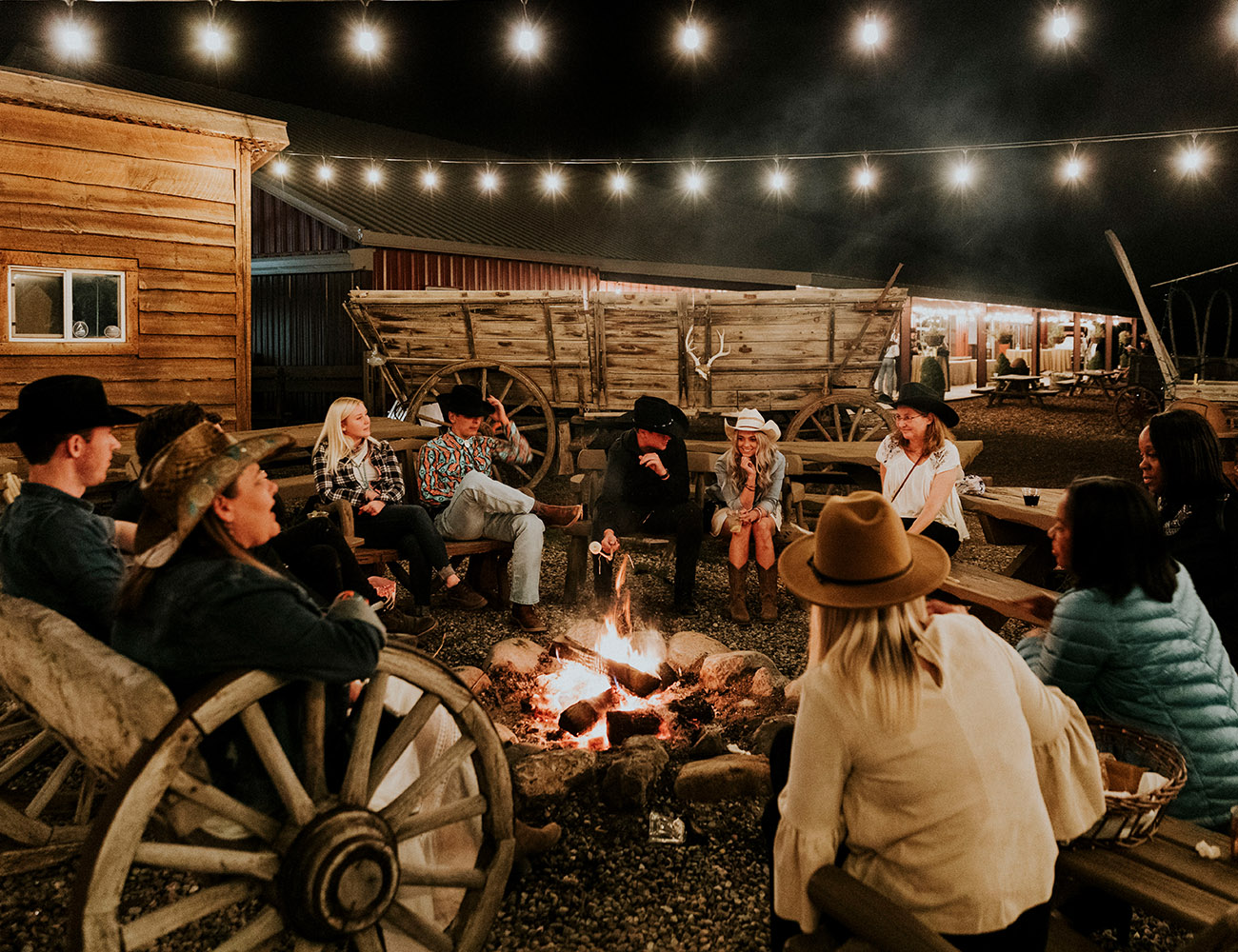 Group of Employees Gathered Around Campfire